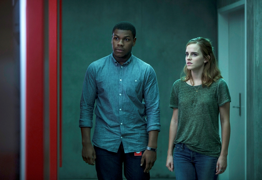 """This image released by STX Entertainment shows John Boyega, left, and Emma Watson in a scene from """"The Circle."""" (Frank Masi/ STX Financing via AP)"""